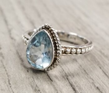 Pear shape blue topaz gemstone and sterling silver ring
