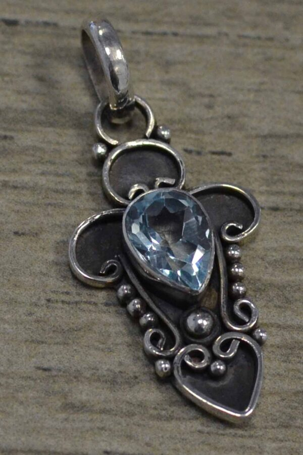 handmade blue topaz and silver swirl design pendant