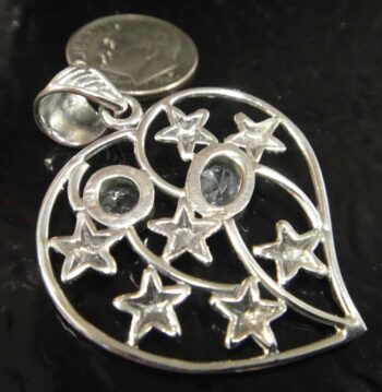 back of blue topaz starfish heart pendant with dime