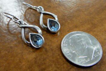 Blue topaz twist design earrings with dime