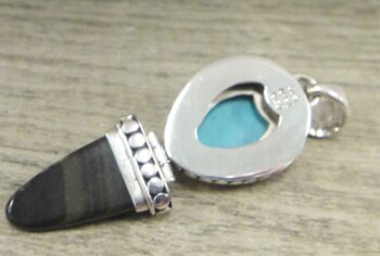 back of blue topaz, turquoise, and obsidian pendant