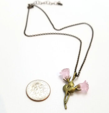 back of pink rose necklace with dime for scale