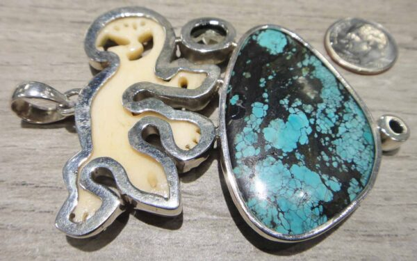 Handmade carved bone lizard, turquoise, green amethyst, and peridot pendant back view