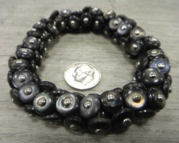 Handmade re-purposed Victorian era boot button bracelet shown with dime (not included) for size comparison