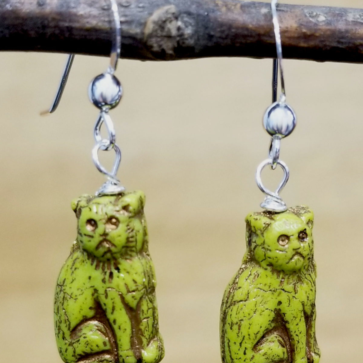 bright green Czech glass sitting cat earrings
