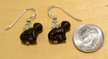 Back side of dark brown ceramic dog earrings, shown with dime (not included) for scale