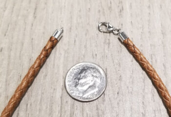 clasp of leather cord with dime for scale