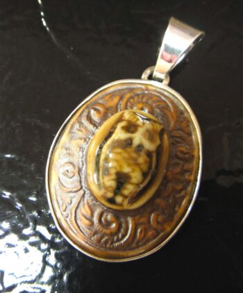 brown porcelain owl with paisley design and sterling silver pendant