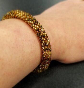 brown Czech glass roll-on bracelet on hand