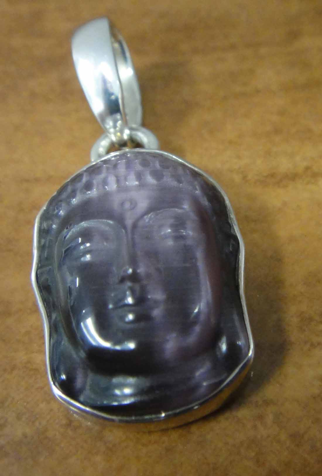 carved purple fiber optic Shiva head and sterling silver pendant