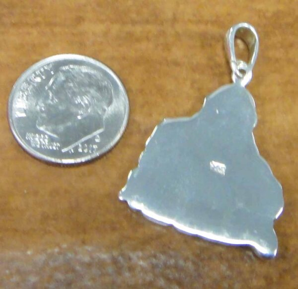 back of sterling silver Buddha pendant with dime for size