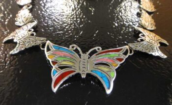 close up of detailed sterling silver and stone butterfly statement necklace