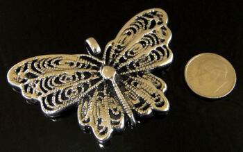 Handmade .925 sterling silver detailed butterfly pendant shown with dime (not included) for scale