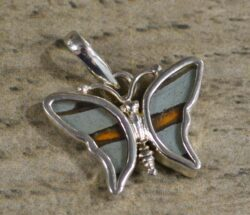 handmade small brown and pale blue butterfly shaped pendant with real butterfly wings