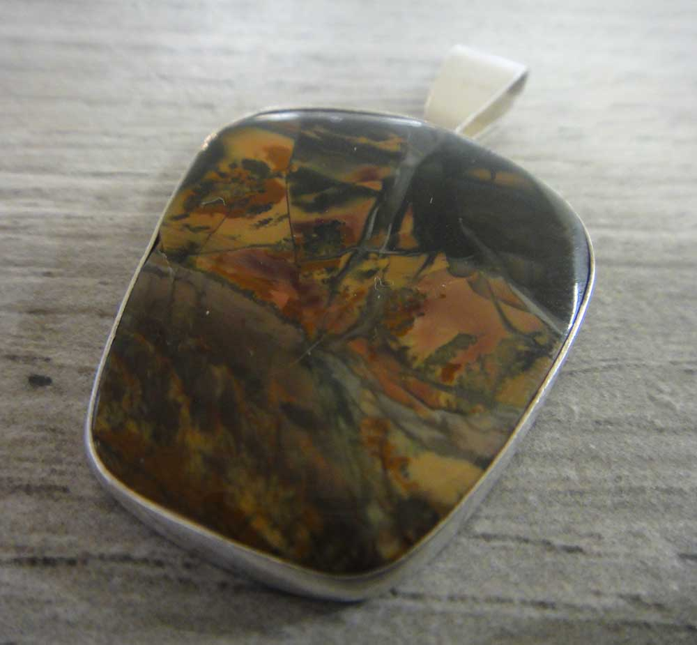 Butterfly wing jasper and sterling silver pendant handmade by Dale Repp in Lone Tree, Iowa