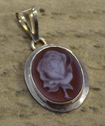Handmade carved red agate rose cameo and sterling silver pendant