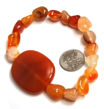 back of carnelian agate gemstone bracelet with dime for scale
