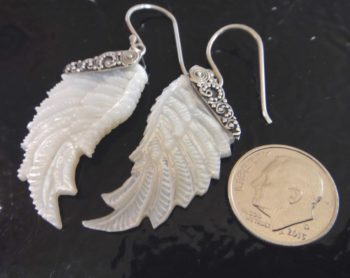 mother of pearl wing earrings with dime for size