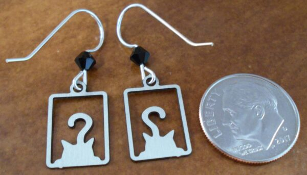 back of black cat earrings with dime for scale