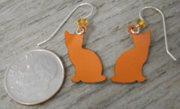 back of orange and white striped cat Sienna Sky earrings with dime