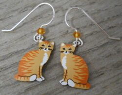 These orange cat earrings are handmade by Sienna Sky.