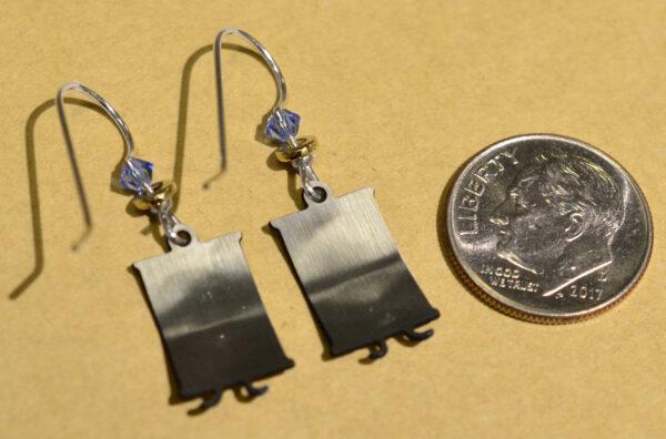 back of silvertone cats sitting in window dangle earrings with dime