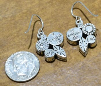 back of Orchid style silver tone earrings by Patricia Locke with dime for size