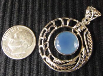 blue chalcedony and sterling silver handmade pendant with dime for scale