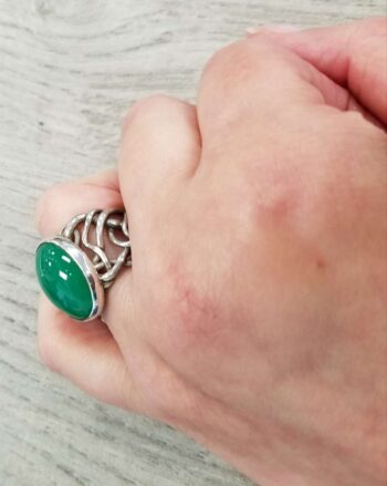sideview of chrysoprase ring on hand