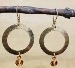 gold-tone earrings with copper swirls by Joseph Brinton