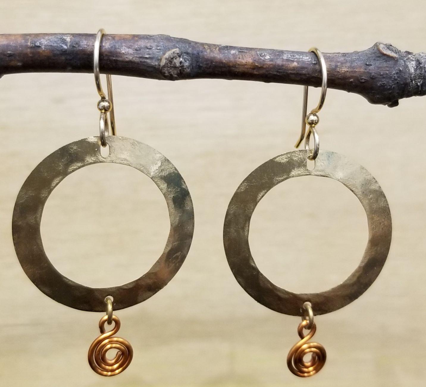 gold-tone earrings with copper swirls by Joseph Brinton