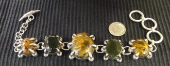 handmade pietersite and moldavite sterling silver claw design bracelete