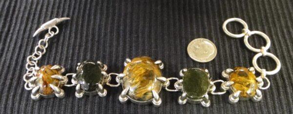 handmade pietersite and moldavite sterling silver claw design bracelete