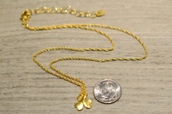 back of 14k gold vermeil clover necklace with dime