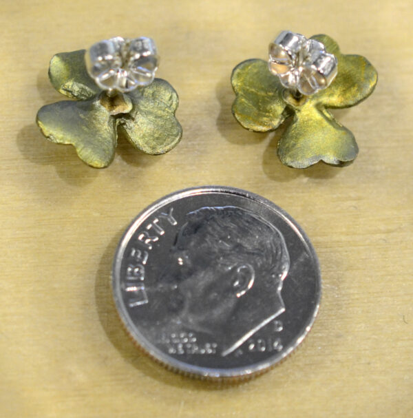 back of Michael Michaud green Clover post earrings with dime