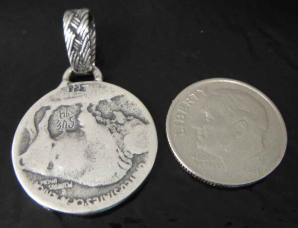 back of carved buffalo nickel sterling silver pendant with dime for scale