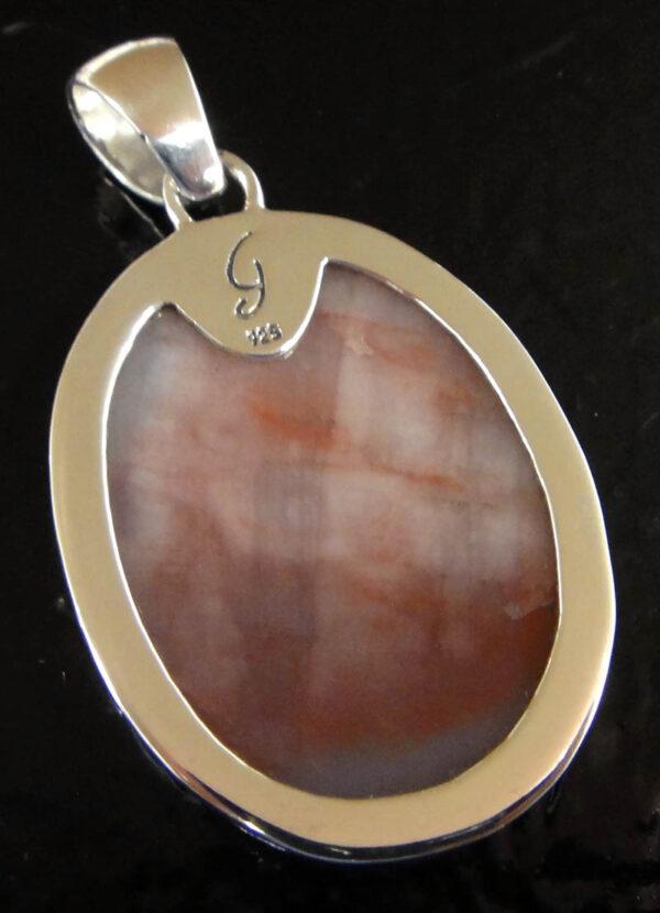 back of light pink petrified wood pendant