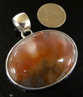 petrified wood and sterling silver pendant with dime for size