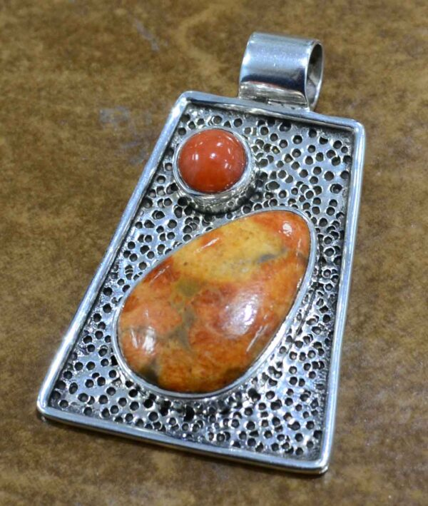 red and orange coral and sterling silver pendant