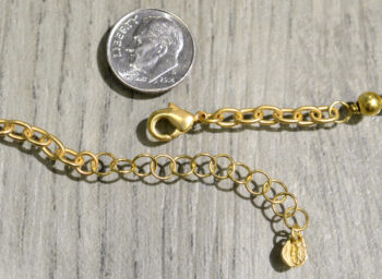 Michael Michaud Silver Seasons cordyline layered necklace clasp, shown with dime (not included) for scale