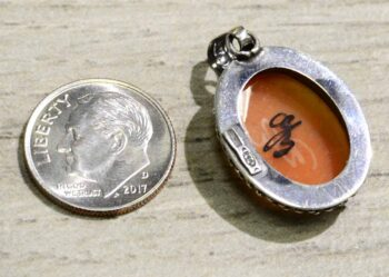 Hand carved cornelian shell woman with flowers cameo pendant back with dime