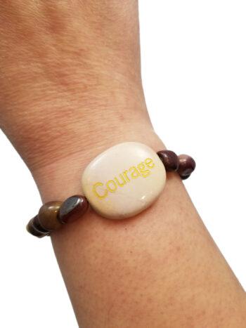 courage bracelet on wrist