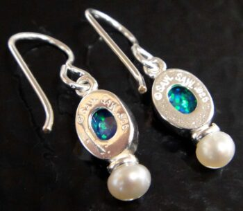 back of black opal and freshwater pearl oval drop earrings with dime