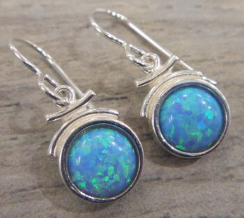 These created blue opal and sterling silver dangle earrings are handmade by Sonoma Art Works.
