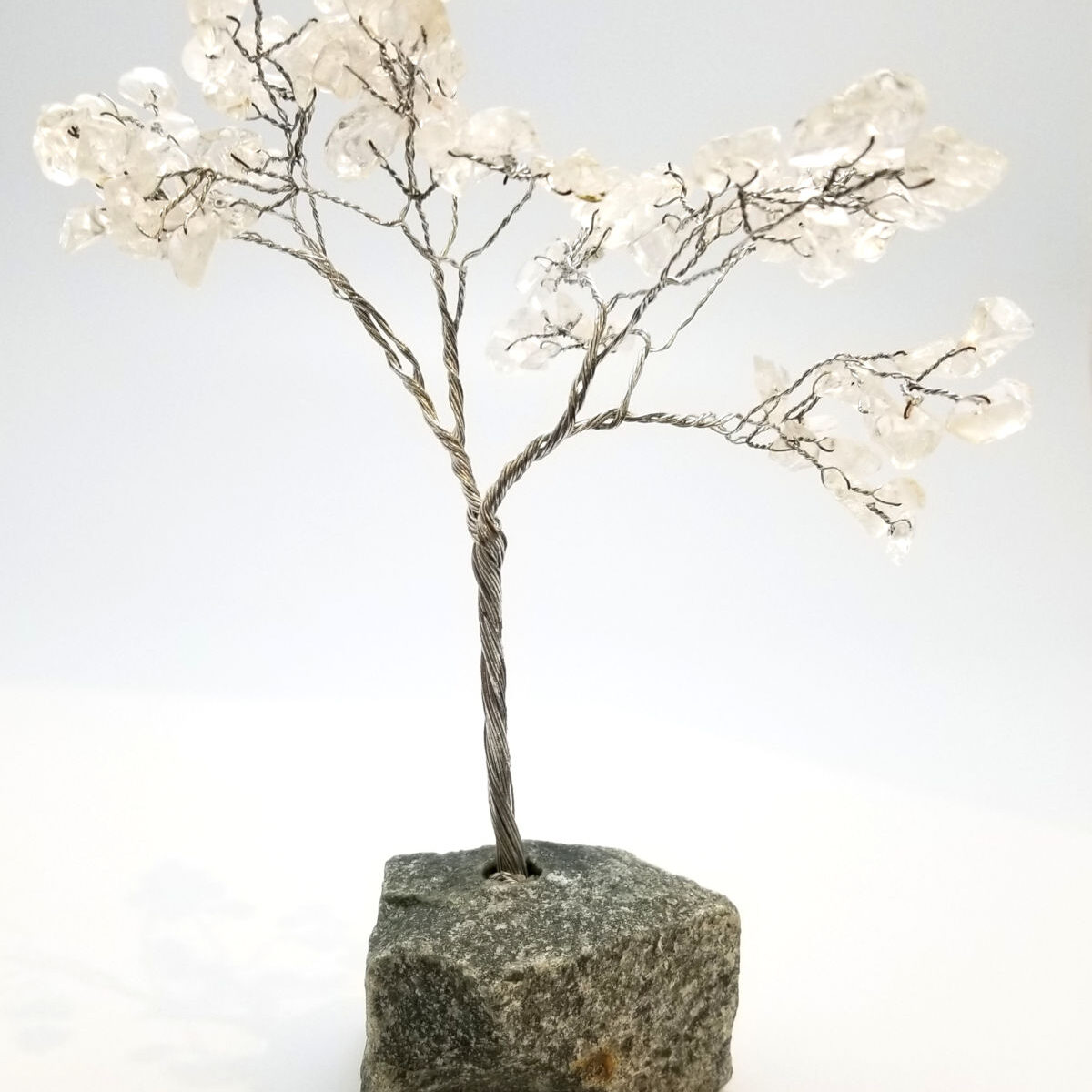 wire tree sculpture with clear quartz crystal leaves