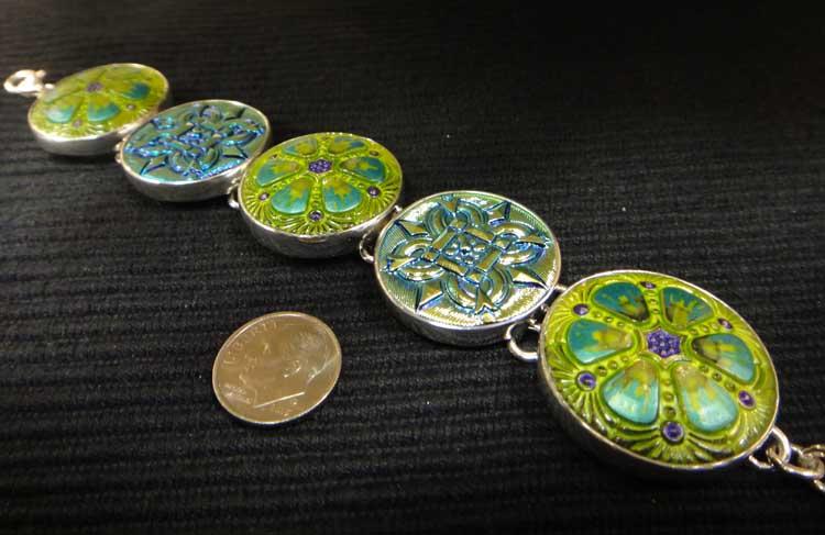 green Czech glass button and sterling silver bracelet