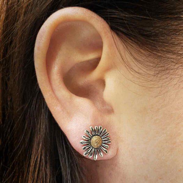 daisy stud earrings on ear