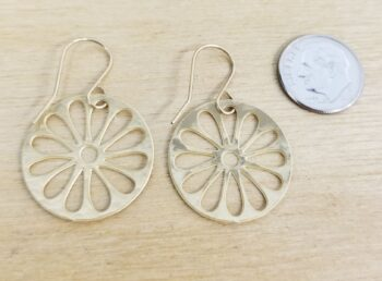 back of goldtone daisy earrings with dime for scale