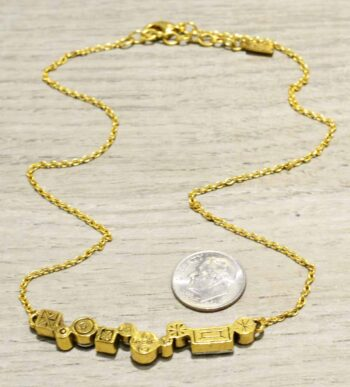 back of Danae two tone necklace by Patricia Locke with dime for size