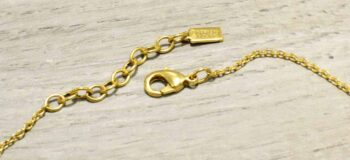 clasp of Danae two tone necklace by Patricia Locke